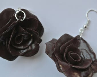 Earrings shaped pink colored flowers Brown