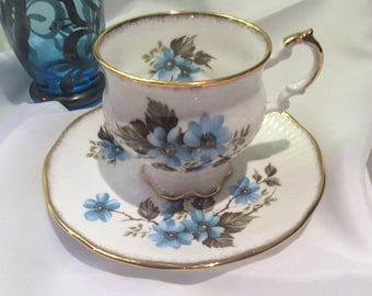 Elizabethan By Taylor and Kent England Pedestal Tea Cup and Saucer Blue Flowers