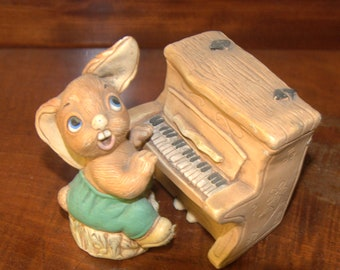 Pendelfin rabbit The Thumper playing a piano