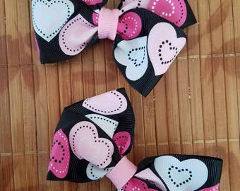 Set of two heart bows