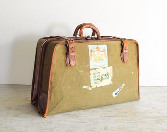 vintage suitcase, luggage, old luggage, world traveler canvas & leather garment bag w/travel stickers, timeworn character, 1940s, vintage