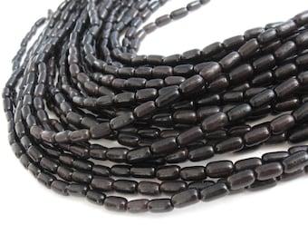 Perles ovales en bois exotique noir naturel 10x5mm - 45 unités
