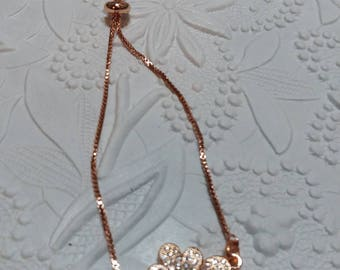 Rose gold slider bracelet with cubic zirconia flower