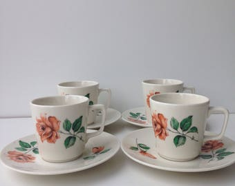 Set of four coffee cups with rose decor