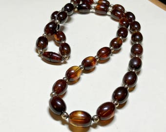 Vintage faux tortoise shell necklace, 23.5 inches, brown necklace, plastic bead necklace, tortoiseshell necklace, brown and gold, 1970s-80s