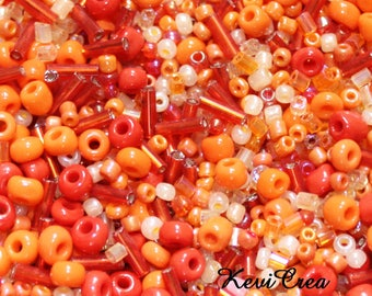 Set of 50g seed beads Orange various sizes and shapes