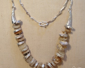 Silver necklace with ancient african flint's little discs