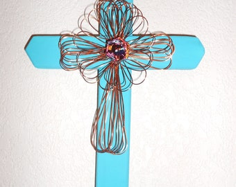 turquoise cross with brass wire cross and blue stone