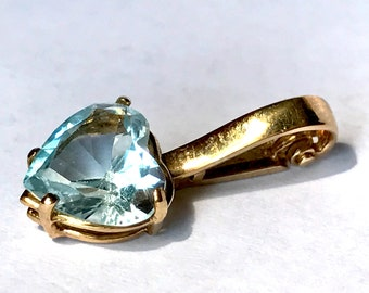 Blue topaz and 14K gold heart shaped pendant