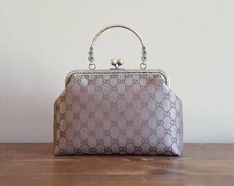Gucci canvas kisslock bag with handle / crossbody bag