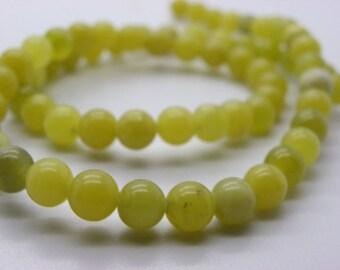 a 65, 68 beads about jade 6 mm yellow ochre jaspe round beige