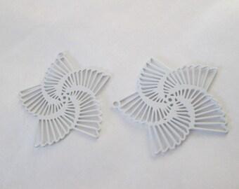 2 white spiral flowers 22 mm metal prints