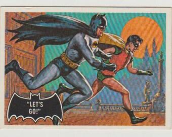 "1966 Topps Batman Trading Card (Black Bat) #28 ""Let's Go"". NM 7.  Topps Company Inc.  DC Comics."