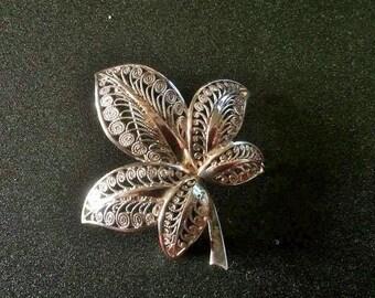 Vintage sterling stamped filigree flower shaped brooch