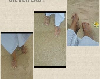 Luxurious beach wedding barefoot sandals