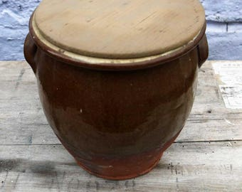 Gorgeous earth tones rustic stoneware pot with original wooden lid.