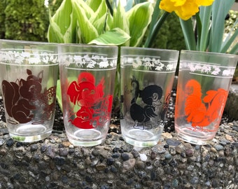 Just delightful!  Four adorable Swanky swigs juice glasses with baby animals.