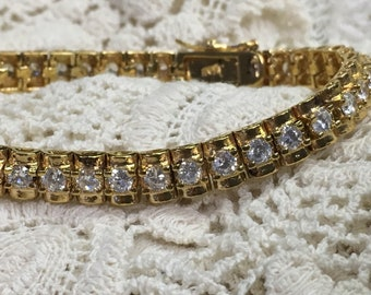 Gold tone and crystal tennis bracelet- 7.5""