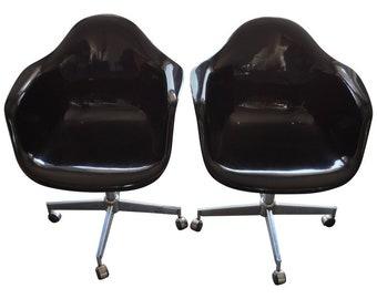Pair of Midcentury Black Fiberglass Shell Swivel Chairs on Steel Wheels Casters