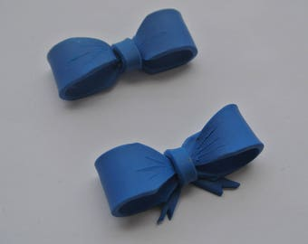 two bows, pieces of polymer clay