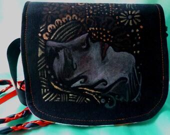 Art textile un d'un style genre sac les face des années 1920 inspiré dans les tons de Bronze