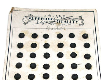"Antique Petite Silk BUTTONS, 71 Victorian Black silk, unused on original card, 1/3"". Pad back."