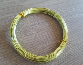 10 meters of metallic pale yellow aluminum wire, diameter 1 mm