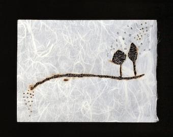 Burnt paper painting, bobbin lace and silver foil, landscape