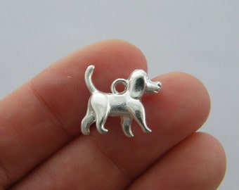 8 Dog charms silver plated A784