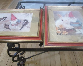 A pair of gnomes one with birds the other with a rabbit