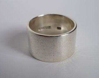 Wide silver band ring