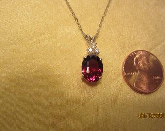 Beautiful Rhodolite Oval Accented Garnet Pendant