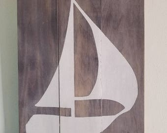 Sailboat on weathered wood