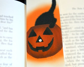 Black Cat in Pumpkin Laminated Bookmark - Sammy Eyes a Pumpkin Illustration