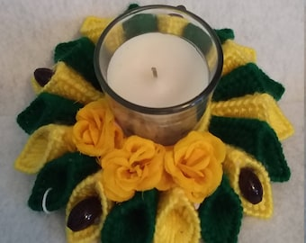 green and yellow  candle holder