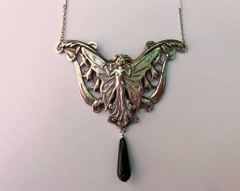 Winged Angel Necklace With Fuchsia Background
