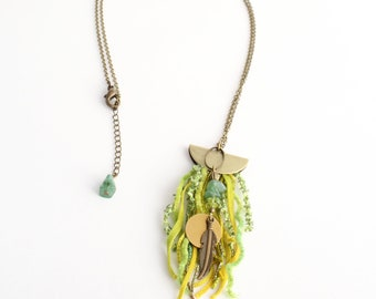 Yellow-green amulet necklace, fiber and aventurine