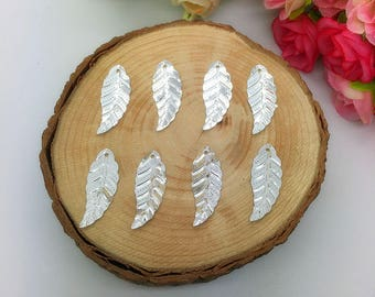 Silver sequin leaves 8 charms