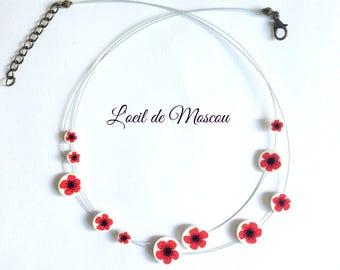 red poppy Flower necklace on shrink plastic