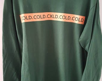 "Northly Clothing Long sleeve Orange on Green ""Cold"" design"