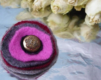Round colorful handmade brooch from recycled wool sweaters