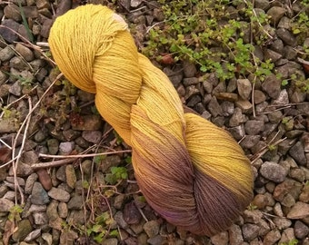 Naturally dyed with foraged dock leaves, dandelion leaves and sustainably sourced Logwood. Super fine merino lambswool, 100g, 600m.
