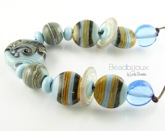 Beadbijoux Handmade Lampwork Glass Bead Set SRA Faded Denim Blue Silvered Ivory Amber Brown