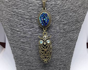 bronze necklace with crystallized blue cabochon and bronze OWL