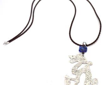 Pendant necklace, dragon, German silver, silver metal pattern. Lapis lazuli and Garnet. Dark brown cord.
