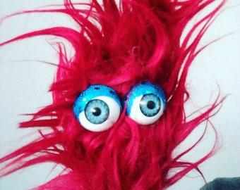 Fuzzy monster finger puppets