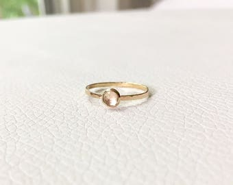14k solid gold and white topaz ring
