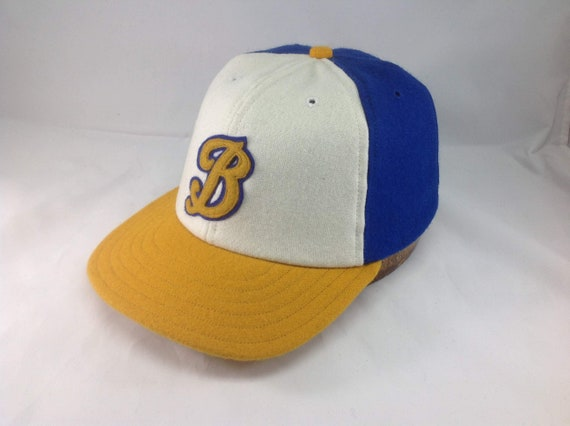 Hand crafted 6 panel wool flannel cap in white, royal blue and gold. Two layer hand cut and stitched felt script B logo. Any size or letter.