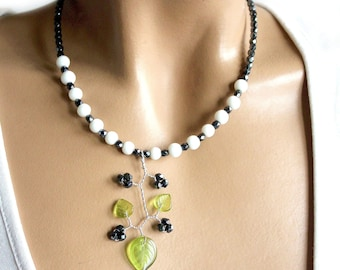 Necklace black white green plunging leaves