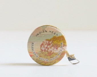 Vintage celluloid souvenir tape measure, Indian Head, Franconia Notch, White Mountains, New Hampshire, sewing, advertising, retractable
